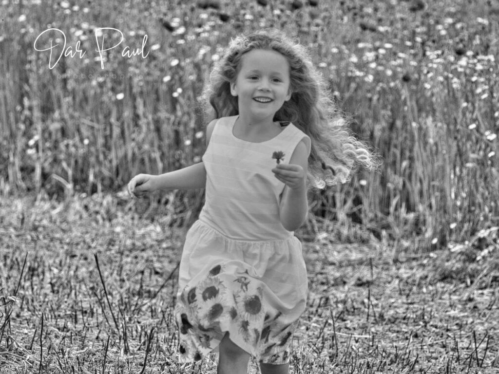 Girl running in field photo